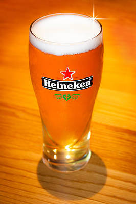 Photograph - A Cold Refreshing Pint Of Heineken Lager by Semmick Photo