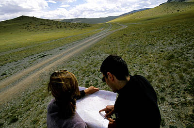 Altai Mountains Photograph - A Couple Hiking Across The Atlai by Olivier Renck