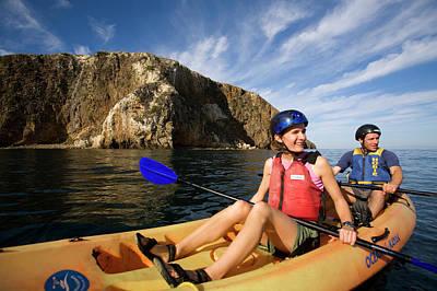 Santa Cruz Island Photograph - A Couple Sea Kayaks Along The Shores by Lisa Seaman