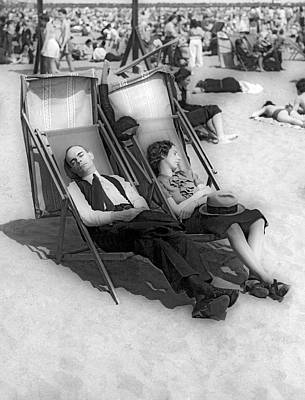 Beach Scenes Photograph - A Couple Sleeps At The Beach by Underwood Archives