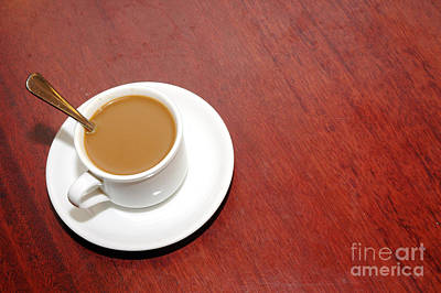Thomas Kinkade Rights Managed Images - A Cup Of Coffee With Creamer Royalty-Free Image by Antoni Halim