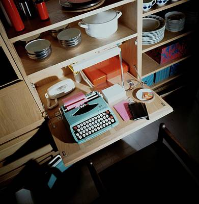 Tableware Photograph - A Cupboard With A Blue Typewriter by Ernst Beadle