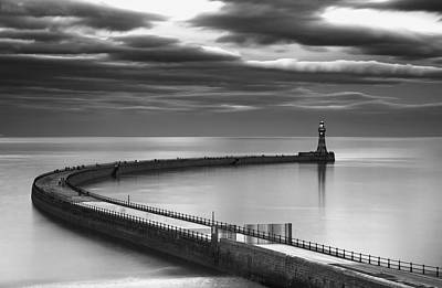 A Curving Pier With A Lighthouse At The Art Print by John Short