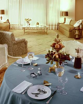 Table Wine Photograph - A Dining Room With A Blue Tablecloth And Ornate by Wiliam Grigsby