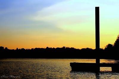 Photograph - A Dock On The River At Sunset by Debra Forand