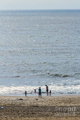 Photograph - A Family Enjoys The Early Morning Atlantic Beach At Ocean City Md  by William Kuta