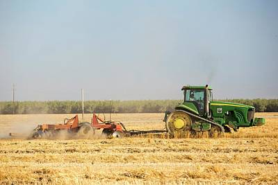 Ploughed Photograph - A Farmer Ploughs A Field In Wasco by Ashley Cooper