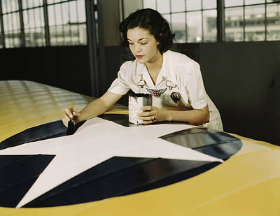 Insignia Painting - A Female Worker Paints The American by Stocktrek Images