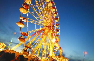 A Ferris Wheel At Night Art Print