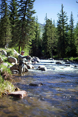 Colorado Fly Fishing River Wall Art - Photograph - A Fisherman Is Fly Fishing At A River by Priscilla Gragg