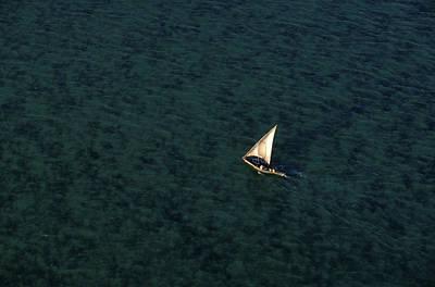 Dhow Photograph - A Fishing Dhow Sailing Near Kiwayu by Robert Caputo