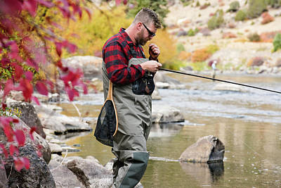 Colorado Fly Fishing River Wall Art - Photograph - A Fly Fisherman Preparing His Gear by Rob Hammer