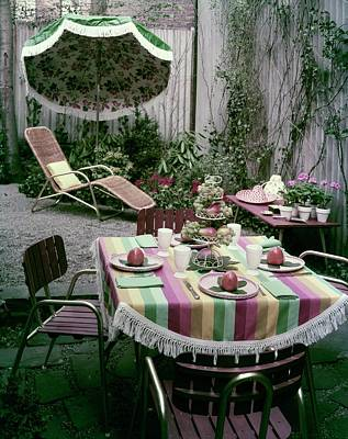 A Garden Set Up For Lunch Art Print by Tom Leonard