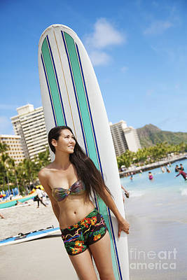 A Girl In A Bikini Standing On The Beach With Her Surfboard_ Oahu, Hawaii, United States Of America Art Print by Brandon Tabiolo