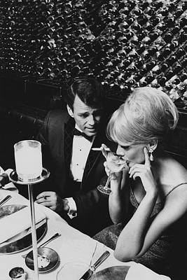 Worn Photograph - A Glamorous 1960s Couple Dining by Horn & Griner