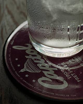 Still Life Photograph - A Glass On A Coaster by Romulo Yanes