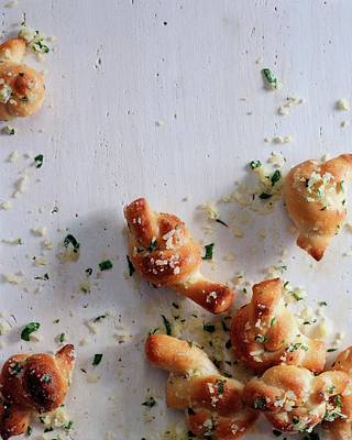 Photograph - A Group Of Garlic Knots by Romulo Yanes