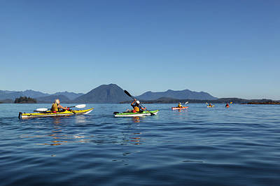 Photograph - A Group Of Kayakers Paddle In The Calm by Ron Watts