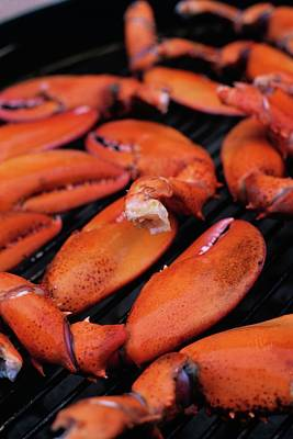 Cooking Photograph - A Group Of Lobster Claws On A Grill by Romulo Yanes