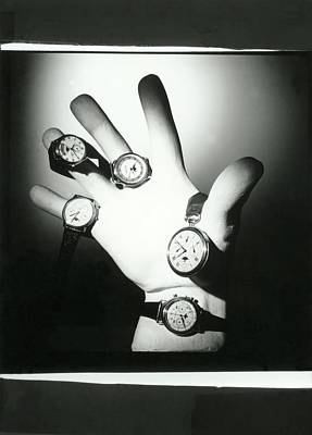 Luna Photograph - A Hand Holding A Group Of Watches by Horst P. Horst