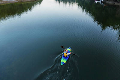 Using The River Photograph - A Kayaker Enjoys An Early Morning by Jerry Monkman