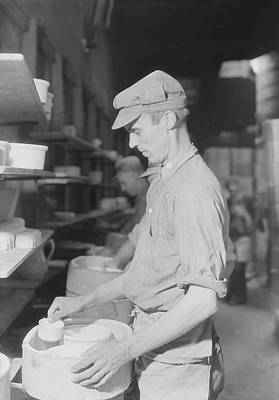 Artist Working Photograph - A Kiln Placer At Southern Potteries by Stocktrek Images