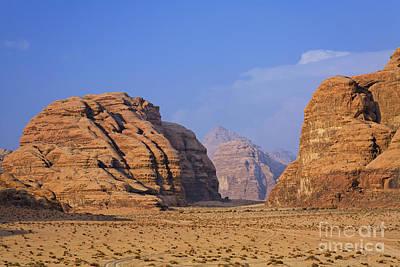 A Landscape Of Rocky Outcrops In The Desert Of Wadi Rum In Jordan Art Print by Robert Preston