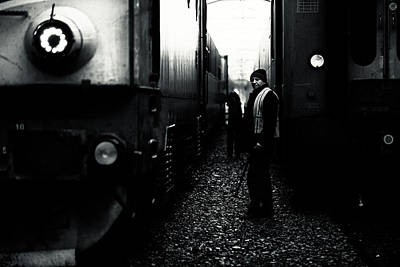 Railroad Station Photograph - A Life Between Trains by Julien Oncete