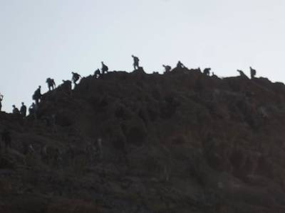 Photograph - A Line Of People Walking On A Mountain by Shea Holliman