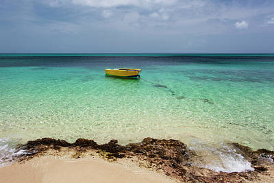 Photograph - A Lone Boat In The Turquoise Water by Jenna Szerlag