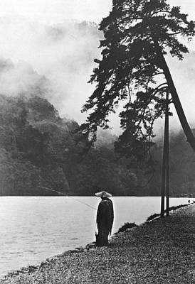 Raincoat Photograph - A Lone Japanese Fisherman by Underwood Archives
