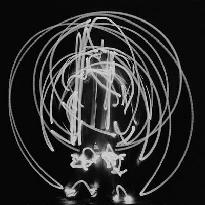 Photograph - A Long Exposure Photograph Of A Man Dressing by Herbert Matter