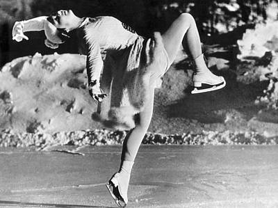 Solo Dancer Photograph - A Lovely Ballet Pose On Ice Skates by Underwood Archives