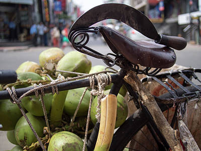 A Machete And A Group Of Coconuts Sit Art Print by David H. Wells