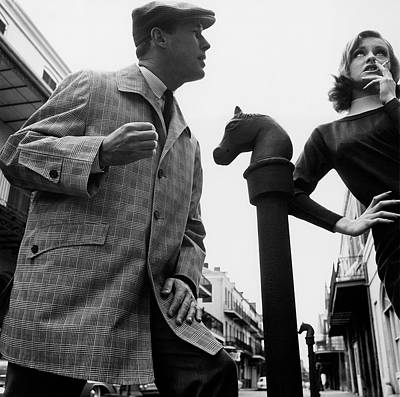 Raincoats Photograph - A Male And Female Model Posing On Chartres Street by Chadwick Hall