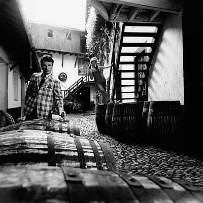 A Male Model Posing By Wine Barrels Art Print