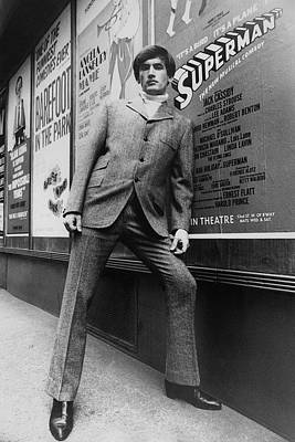 Lapel Photograph - A Male Model Posing In Front Of An Advertisement by Horn & Griner