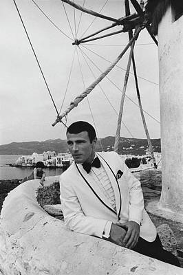 A Male Model Posing On A Terrace In Mykonos Art Print by Leonard Nones