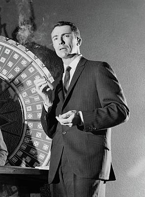 Photograph - A Male Model Wearing A Dark Pinstriped Suit by Richard Waite