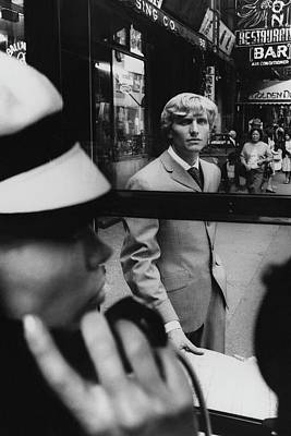 1960s Fashion Photograph - Woman In Telephone Booth Watched By Man by Horn and Griner