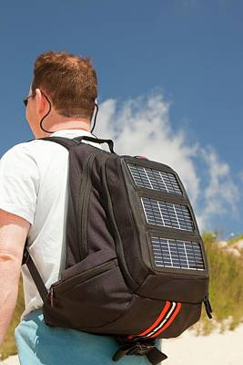 Backpack Photograph - A Man Carrying A Solar Backpack by Ashley Cooper