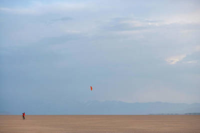 Alvord Desert Wall Art - Photograph - A Man Flying A Kite In An Open Desert by Wood Wheatcroft