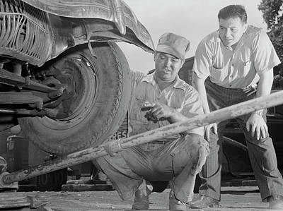 Photograph - A Man Has Tires Checked And Adjusted by Stocktrek Images