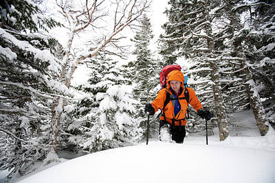 Technical Photograph - A Man Hiking Through The Snow On Mt by Jose Azel