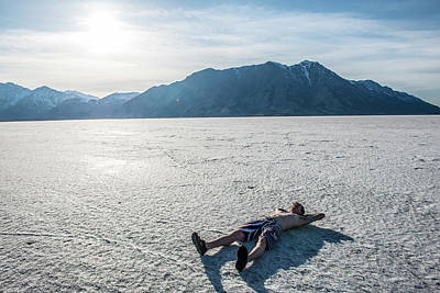 A Man Lays In The Sun On A Frozen Lake Art Print