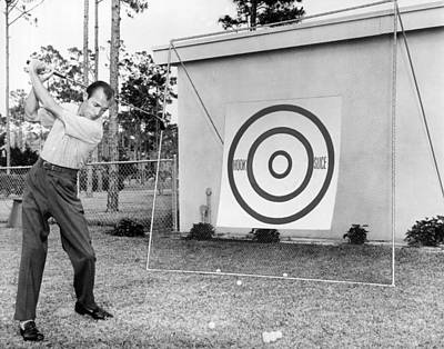 Photograph - A Man Practices Golf by Underwood Archives