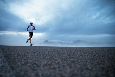 Self-confidence Wall Art - Photograph - A Man Running Out By The Bonneville by Mike Schirf
