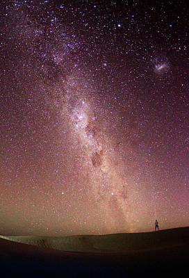 Photograph - A Man Shining A Light Towards The Milky by John White Photos