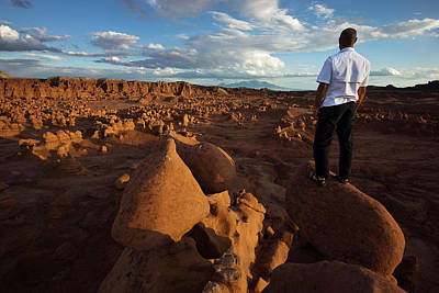 Goblin Valley State Park Photograph - A Man Standing On Rocks Overlooking by Whit Richardson