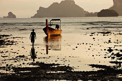 Longtail Wall Art - Photograph - A Man Walking Away From His Longtail by Patrick Orton